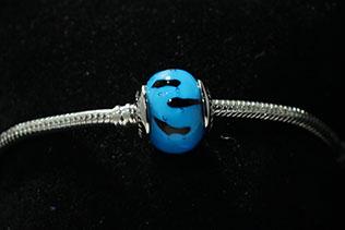 Perle Ronde Bleu Tigré Noir